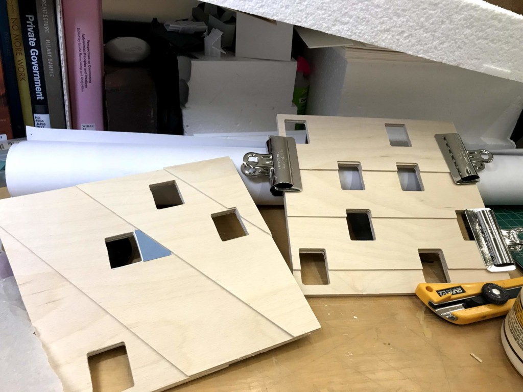 Clamping the pieces while they glue together